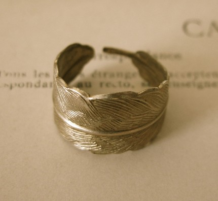 bent brass feather ring